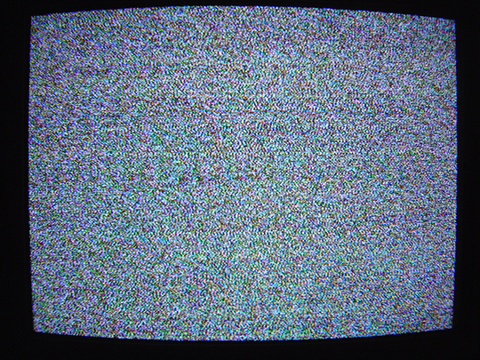 Photograph of a television with static on the screen