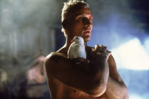 Still of a shirtless man holding a white dove from the film Blade Runner.