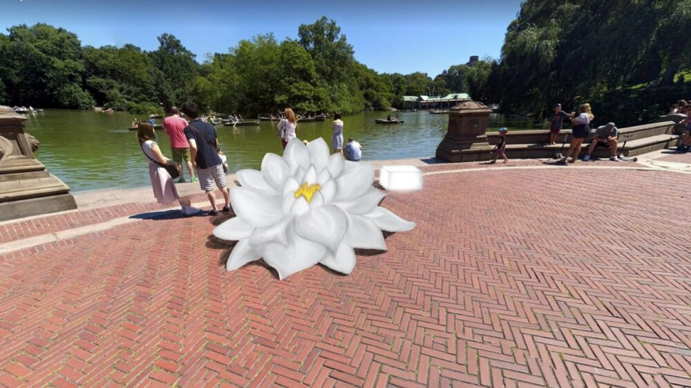 Photograph of Bethesda Terrace with a rendering of a large water lily at the edge of the water