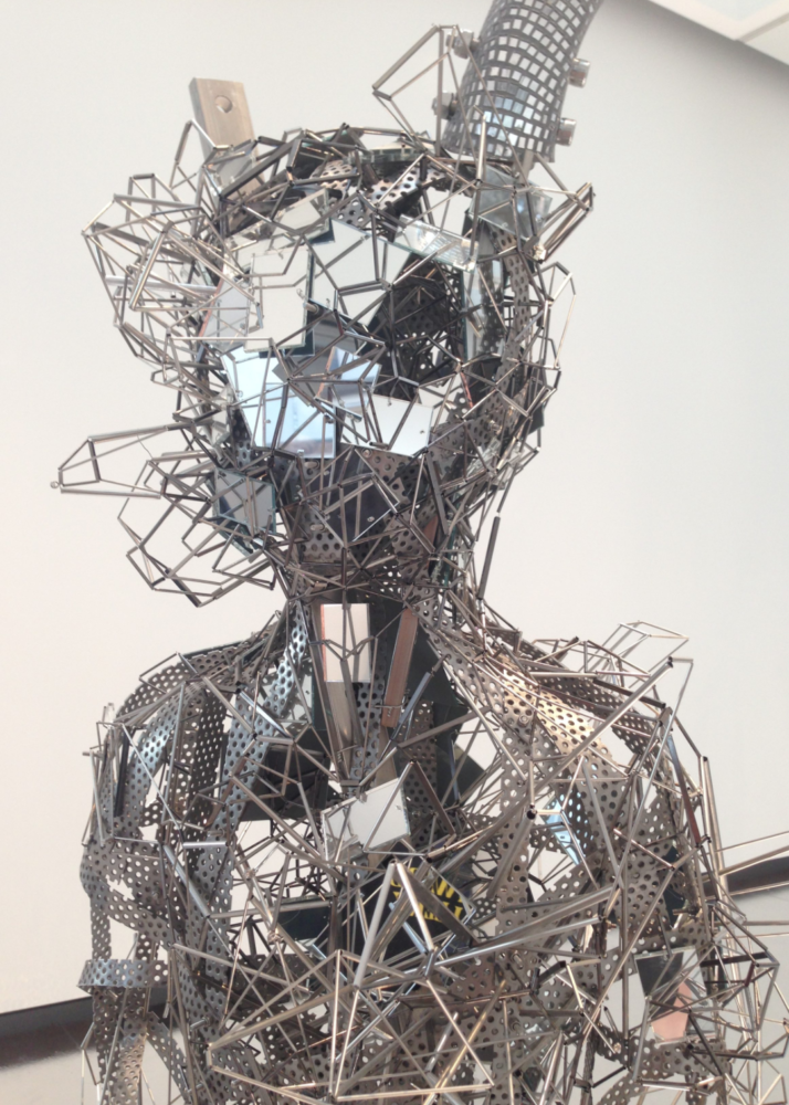 Bust made of mirrors, wire, and other metals