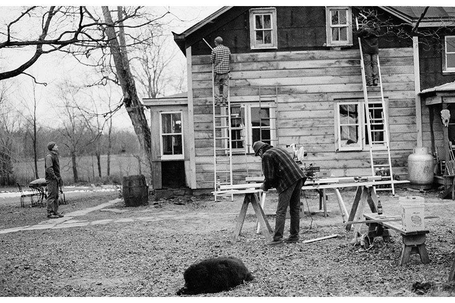 Construction work on the side of a house (in black and white).