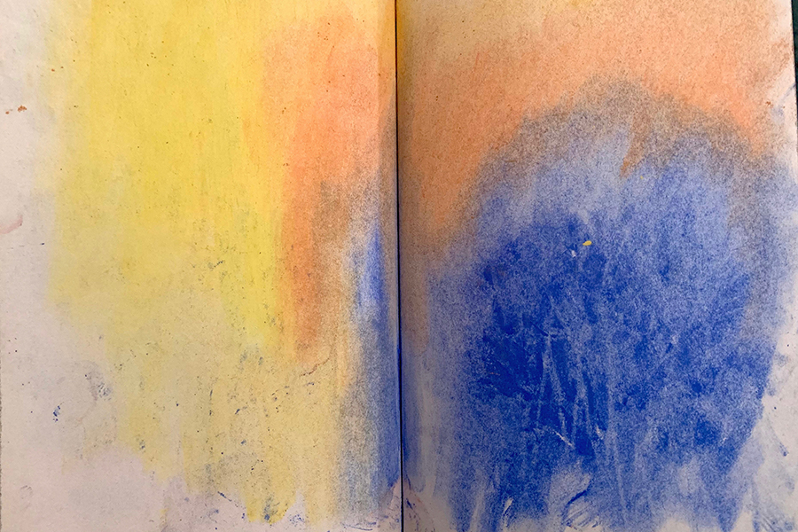 """Drawing: Yellow """"cloud"""" starts on the left side of the page, makes its way into a peach color, and finally ends up as blue in the bottom right corner of the page."""