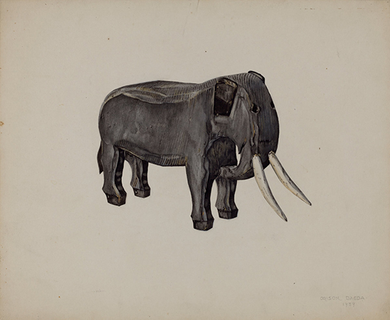 A sculpted wooden elephant on a tan background