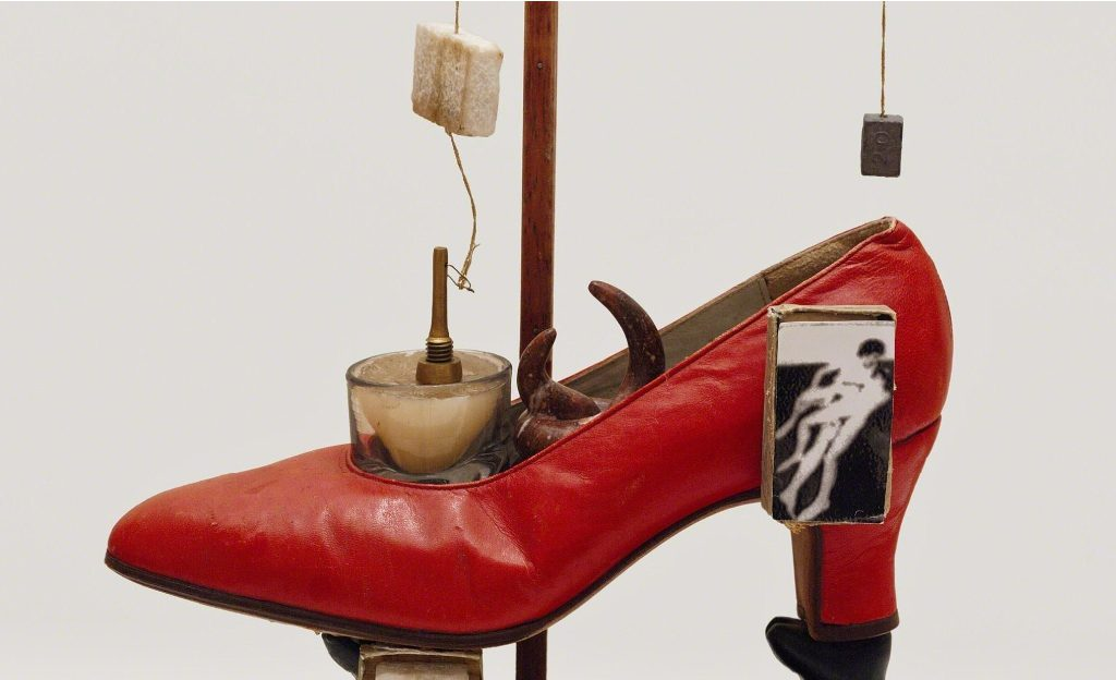 Abstract sculpture of a red shoe.