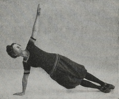 Woman doing a side plank with one arm stretched upward.