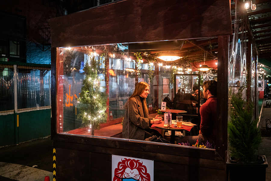 A couple enjoys a well-lit date night at a foodshed.