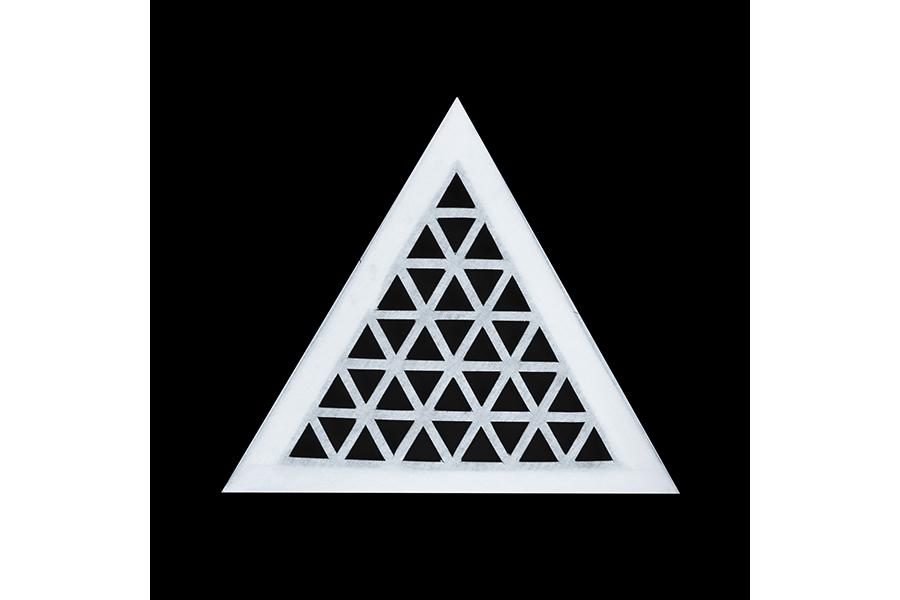 A single latticed triangular panel on a black background.